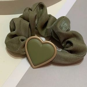 2/$30 Scrunchies with heart shaped charm